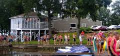 Group of people waiting to cross Lake Gaston