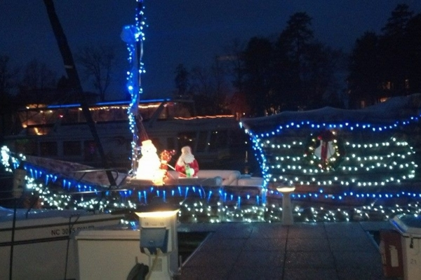 Lighted boats on the water for Christmas in July at Eaton Ferry